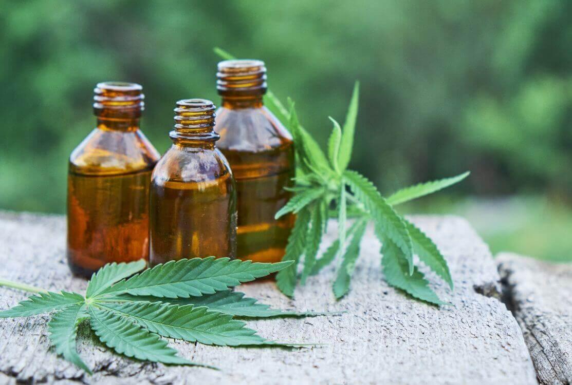 marijuana leaves and medicine bottles