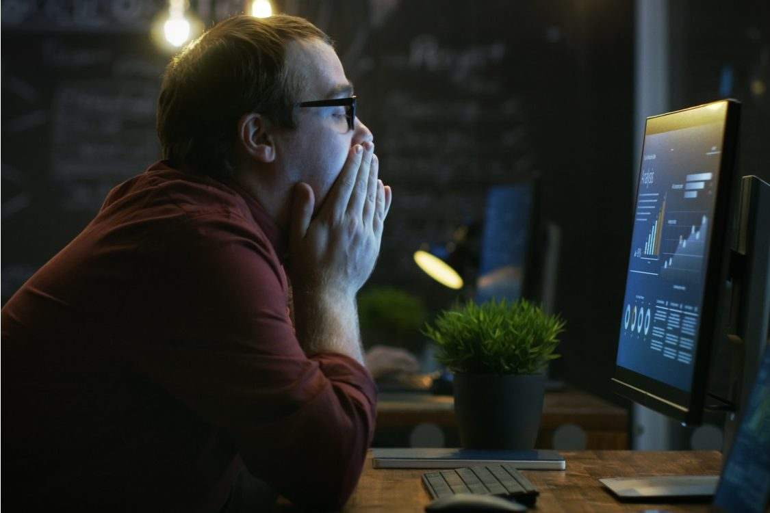 Stressed worker at computer